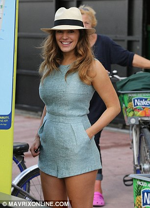 Hat's off to you: Kelly looked beautiful as she stood in her retro light blue romper ahead of her bike ride