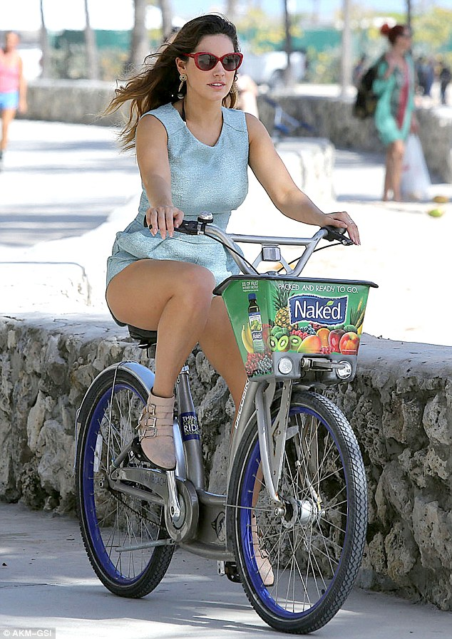 Looking wheely good: Kelly rode along South Beach to an outdoor gym with David