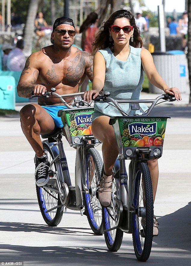 Miami heat: Kelly was more covered up than her beau, who wore a pair of tiny blue shorts for the bike ride