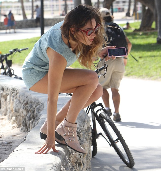 Athletic: Kelly's one-piece outfit showed off her perfect pins as she rode around the Florida city in rented bikes with her beau of just one month