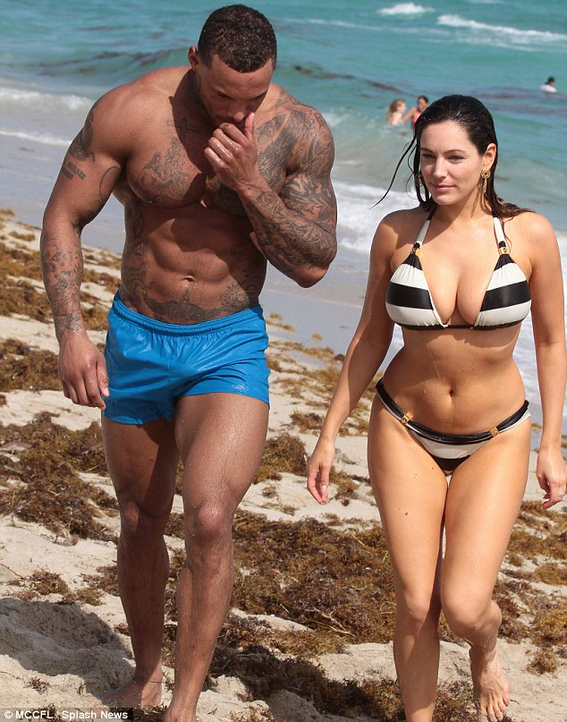 Beauty and the hunk: David looked extremely muscular as he walked along next to Kelly
