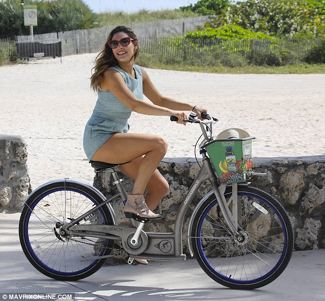 Picture perfect: The Kent-born beauty looked as though she was starring in her very own advertisement as she pedalled along the boulevard