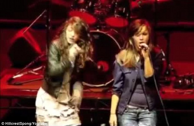 Born performer: The 17-year-old star took vocals alongside a young female friend while the other member of her band Extreme, played guitars and drums