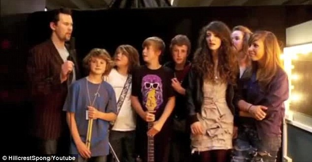 Young stars: Lorde looks cool as she poses next to her school yard bandmates