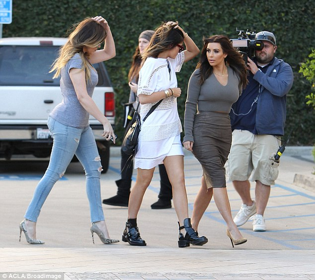 'We started filming so I wanted a fresh look': The reality TV star debuted her makeover on an outing with sisters Khloé Kardashian (left) and Kylie Jenner on Saturday, which was being filmed for their E! series Keeping Up With The Kardashians