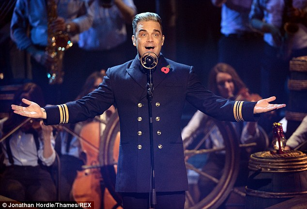 It'll be a shock no more: Robbie Williams, pictured on The X Factor last month, has had to be let in on his surprise 40th birthday plans organised by his wife Ayda this week