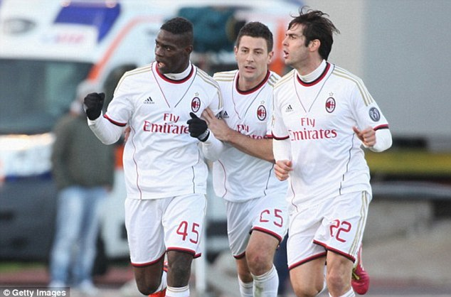 Naughty boy: Balotelli (left) was suspended and fined following his 'provocative' celebration at Cagliari