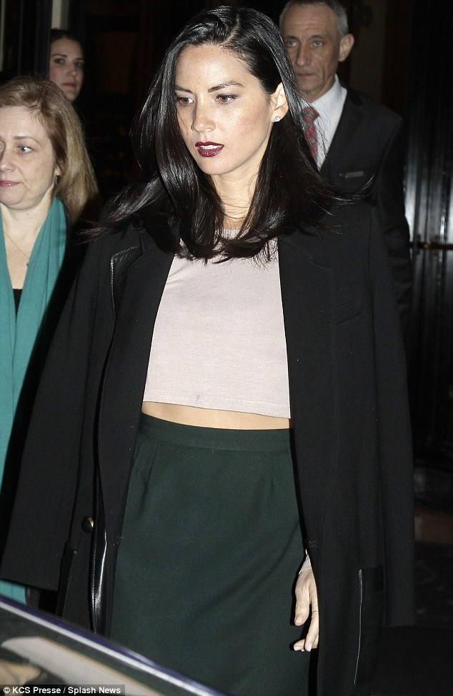 Sultry: Olivia opted for some vampy, dark purple lipstick while her dark hair was worn down over her shoulders