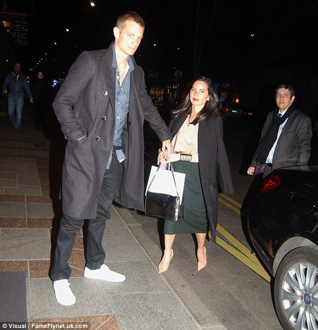 Helping hand: Joel towered above his other half, despite the fact she was wearing a pair of heeled, nude Louboutins