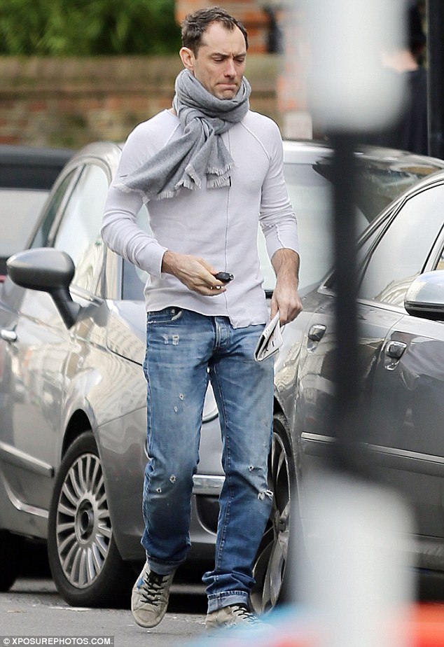 hunky: Jude was spotted getting in his car looking hunky and muscular in  grey top and scarf