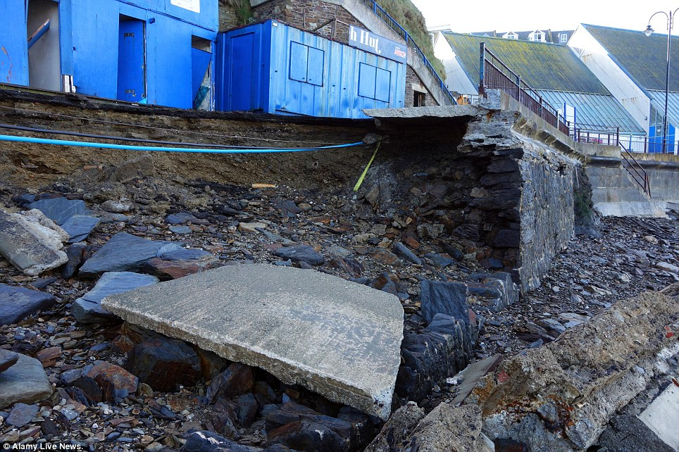 Destruction: Another view of damage to the promenade and seafront in Newquay, Cornwall, from the recent Atlantic storms