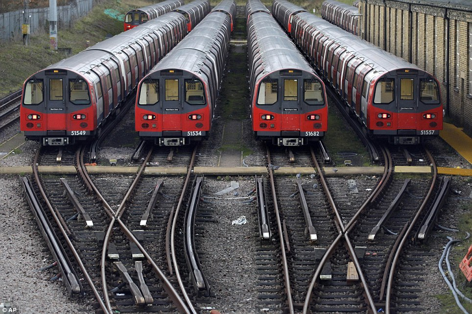 Parked: London Underground workers launched a 48-hour strike tonight in a row over ticket office closures, causing travel chaos in the capital (file picture)