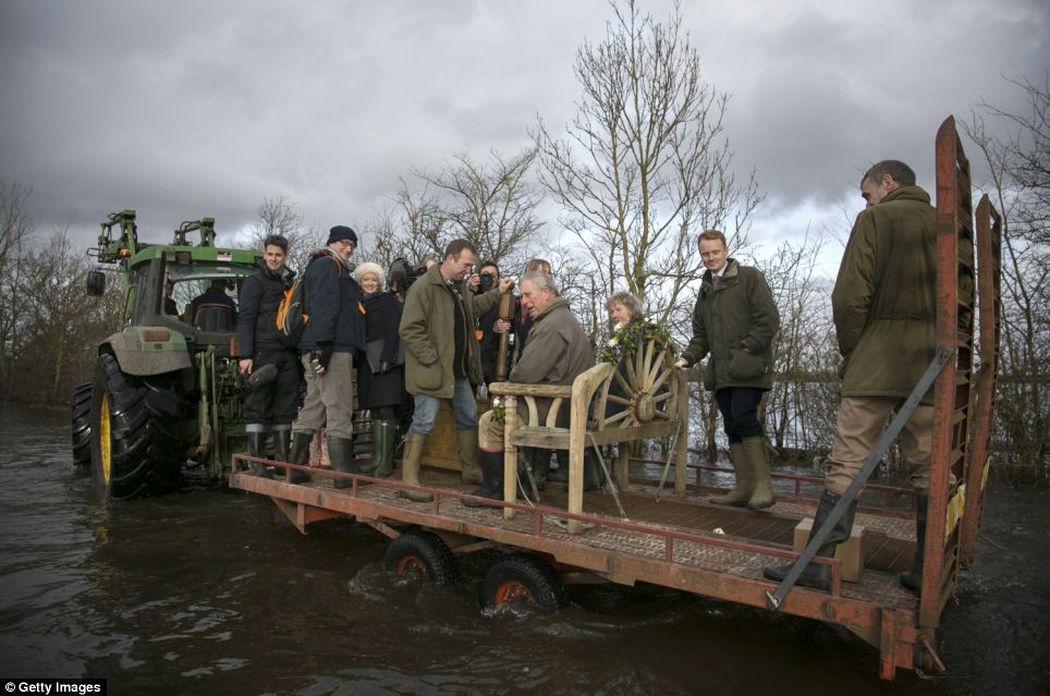 Throne: Villagers contructed a make-shift throne for Prince Charles onboard a tractor trailer so he could visit the worst parts of the flood-hit village of Muchelney today