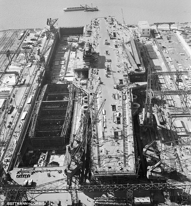 Last-minute construction work is rushed on the U.S. Navy's super-aircraft carrier, the U.S.S. Forrestal in 1954. The U.S. Navy craft will now be sold for scrap
