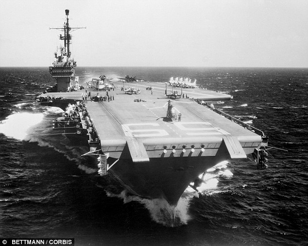 The aircraft carrier USS Forrestal, pictured in 1956 undergoing jet plane training exercises in the Caribbean. It embarked on its final voyage today from Philadelphia to be turned into scrap in Texas