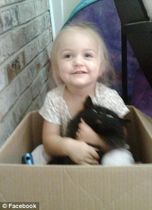 Grim: The three-year-old, pictured, was stored in a suitcase and then in a freezer for three days after they beat the child to death, police said Tuesday