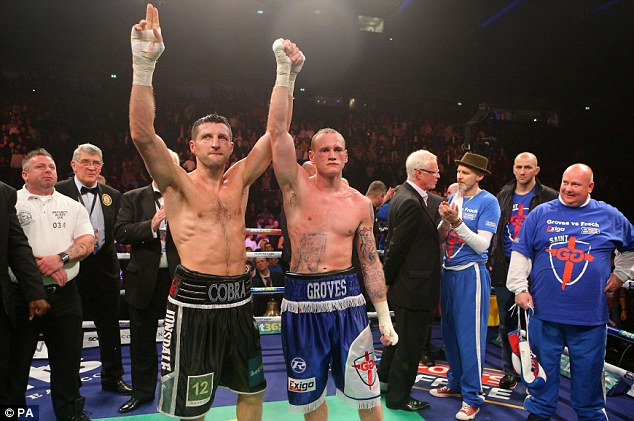 Rivals: Froch (left) raises defeated Groves hand after winner their WBA and IBF Super Middleweight title fight