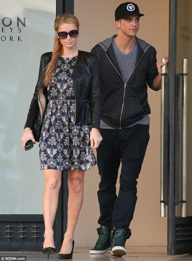 Same old: Paris Hilton and her toyboy beau visited a designer shop in Los Angeles on Tuesday