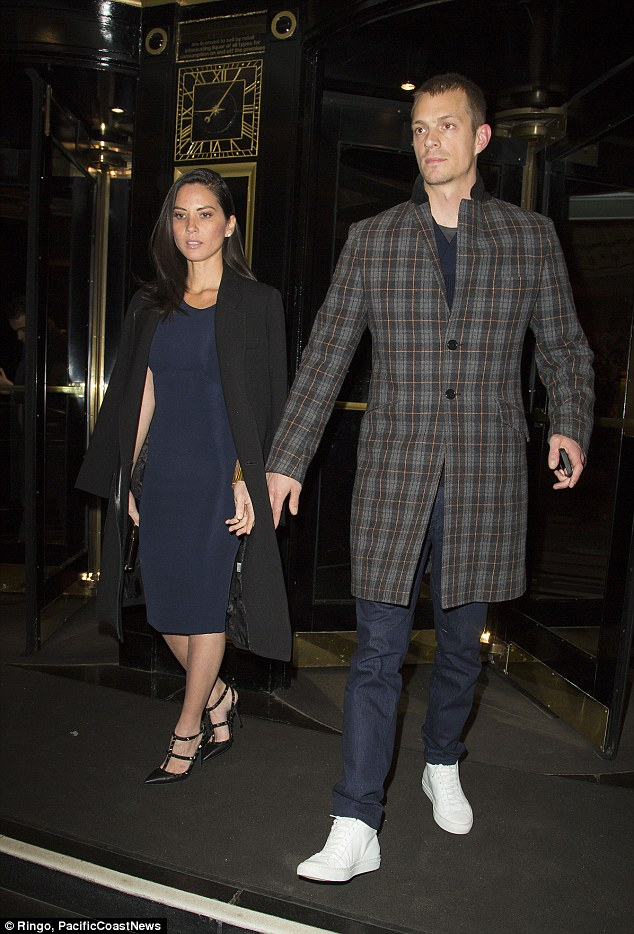 Not so blue: The couple had clearly co-ordinated their looks and were well-matched