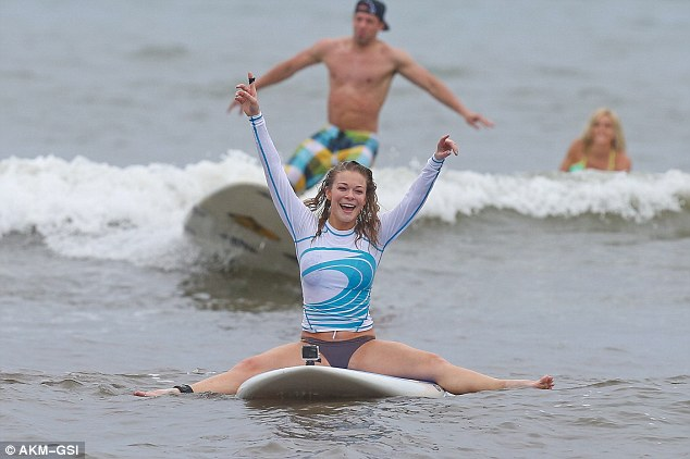 Surf's Up: LeAnn Rimes showed that practice makes perfect as she confidently took to the water at Uncle Bryan's Surf School in Hawaii.