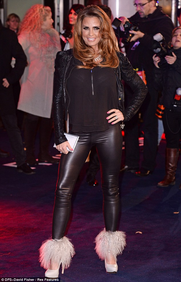 Eye catching: Katie Price stands out at the world premiere of RoboCop thanks to the fluffy embellishments on her white heels