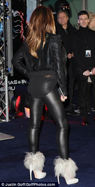 Making an entrance: She's not in the film, by the mother of four still managed to draw attention to herself after arriving at London's BFI IMAX for the world premiere of RoboCop on Wednesday evening