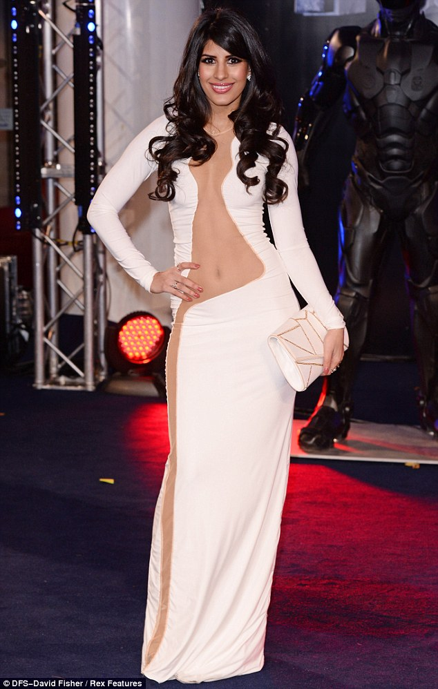 Hard to miss: TOWIE star Jasmin Walia stood out at the world premiere of RoboCop on Wednesday evening thanks to the plunging sheer detail of her sweeping white evening gown