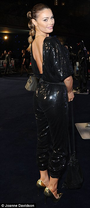 Sparkling: Chloe's shimmering, eighties themed jumpsuit featured a distinctive plunging back detail