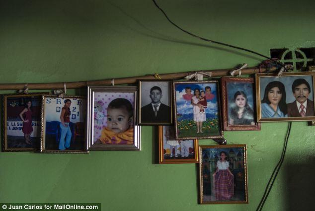 Memories: Photos of Alvarenga's family adorn the walls of their home