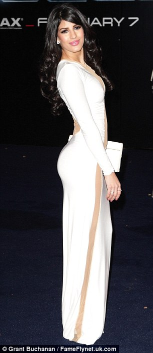 It's a sheer drop: Jasmin displays the tapered sheer slash that dominates her white evening gown