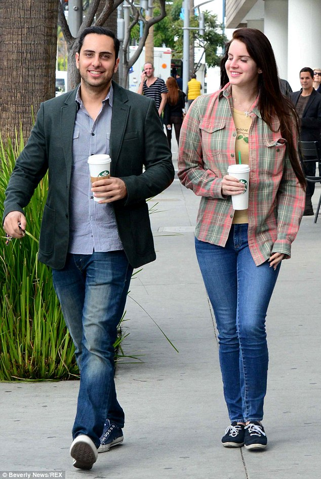Coffee time: Lana grabbed some Starbucks with a male friend