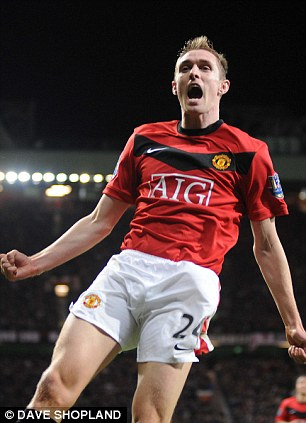 Celebrating: Fletcher (pictured) is happy to be back playing football after battling his 'career-threatening' illness