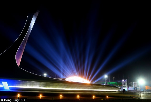 Bright promises: Olympic cauldron is lit up at night in the coastal cluster Olympic Park ahead of Sochi 2014