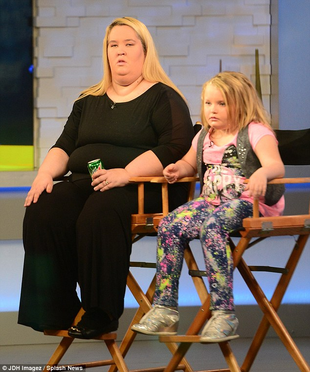 Changing her mood: Once the cameras were rolling, Alana appeared to come over all shy as she sat with Mama June