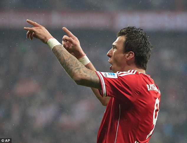 Up top: Mario Madzukic is one of several strikers Arsenal are looking to renew interest in this summer