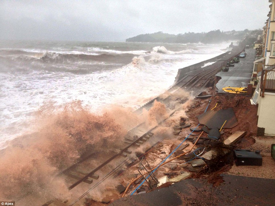 Smashed: Isambard Kingdom Brunel¿s seaside railway line at Dawlish now looks as though some raging giant has crushed it under his heel