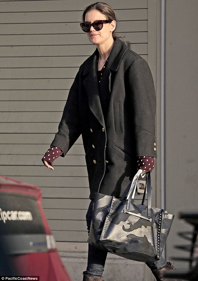 Out and about: Katie Holmes looked a bit worse for wear as she dropped off daughter Suri Cruise, 7, at school in New York City on Thursday