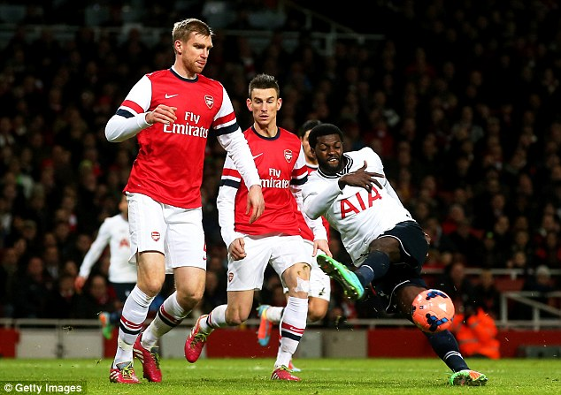Rock solid: Per Mertesacker (left) has formed a dominant partnership with Laurent Koscielny at the heart of Arsenal's defence