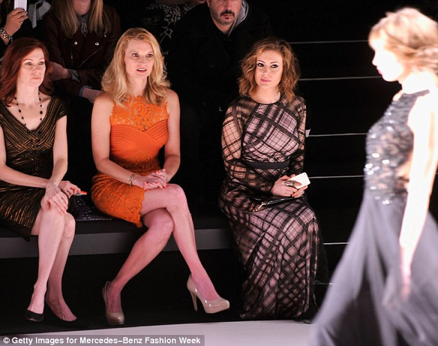 Star quality: Forty-six-year-old actress Carrie Preston and Mistresses starlet watch a model parade down the runway