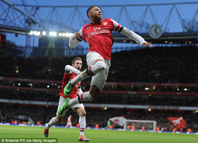 In top form: Arsenal travel to Anfield to face Liverpool as the top side in the Premier League