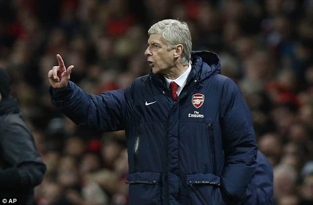 Tough run: Arsene Wenger has guided Arsenal to the top of the Premier League with 14 games to go