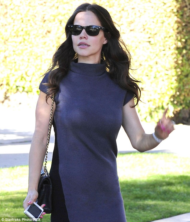 Shady lady: Tammin slipped on her Ray Ban sunglasses on the sunny California day
