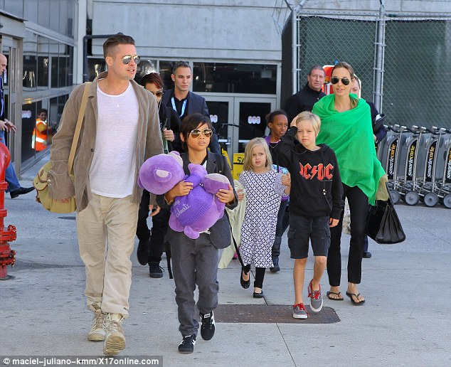 Brad Pitt and Angelina Jolie arriving at Los Angeles Airport after their trip to Australia with their family