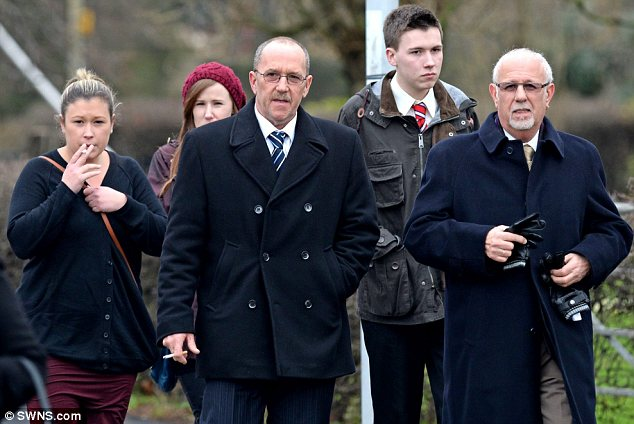 Trial: Kingsman and his daughter arriving at Peterborough Crown Court with other relatives last month