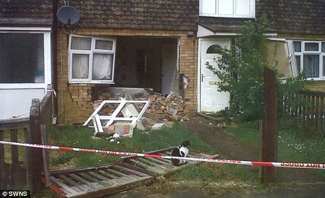 Destruction: Kingsman shouted 'That's how you bang on a f***ing wall' as he drove his 4x4 through the wall