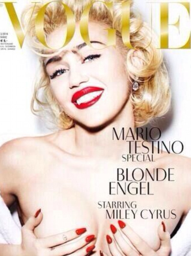 She's at it again! Tweeting on the same day, Miley also gave her fans a sneak peek of a topless cover for Vogue Germany's March 2014 issue
