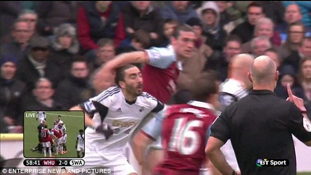 Caught: Carroll hit Chico Flores on the forehead as he turned around following an aerial challenge. Referee Howard Webb, who had a good view of the incident, had no hesitation in sending off the England striker