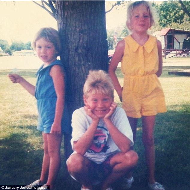'I'm the tomboy crouching in the middle!': January Jones posted this cute Instagram snap of a much younger version of she and her sisters Jina and Jacey Jones on Thursday... showing off her 'tomboy' style in the middle