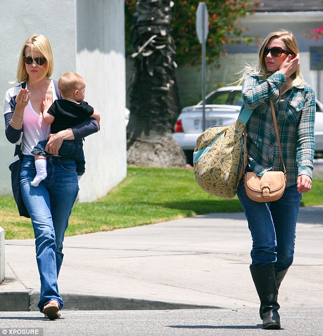 Close-knit: January was spotted heading out to lunch in Los Angeles with one of her sisters back in 2012, with Xander in her arms