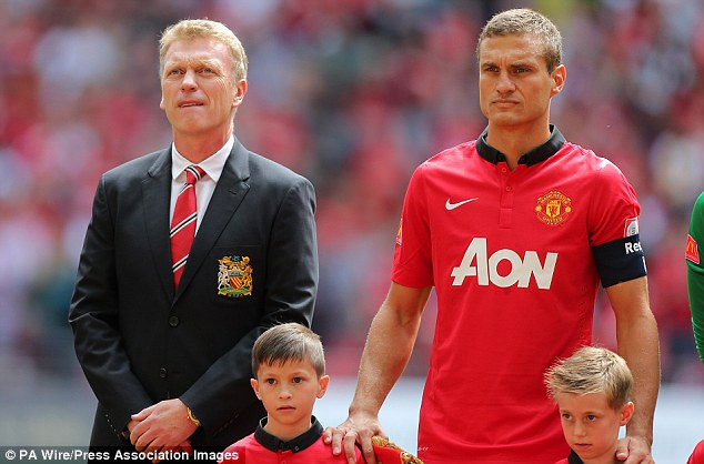 Losing out: United manager David Moyes will be planning for life without Nemanja Vidic next season